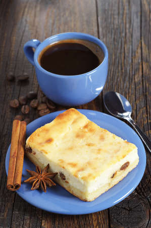 food still: Blue cup of hot coffee with cheesecake on old wooden table