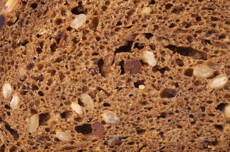 black bread: Black bread with sunflower seeds background texture. Macro photo