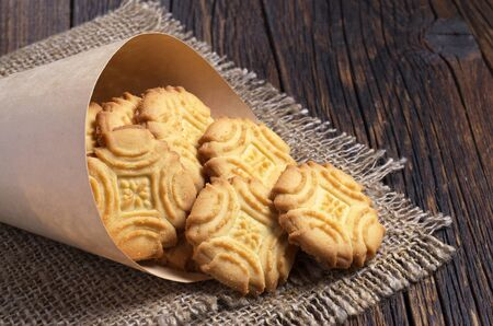 shortbread: Biscuit shortbread cookies homemade in paper bag on the table Stock Photo