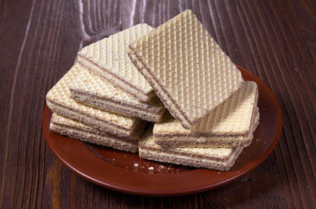 wafers: Wafers in plate on a wooden table Stock Photo