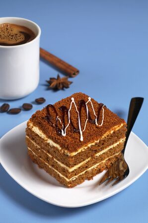 honey cake: Honey cake and cup of coffee on a blue table Stock Photo