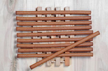 Tasty rye bread sticks on wooden background, top view 免版税图像