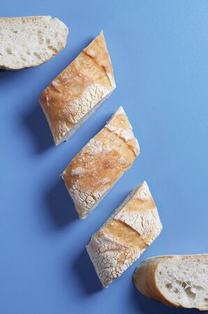 Slices of fresh tasty bread on a blue background, top view Reklamní fotografie