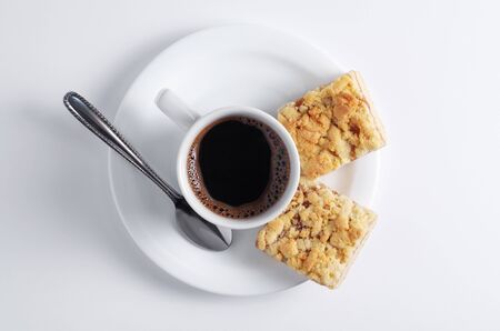 Cup of coffee and cookies with jam on white background, top view