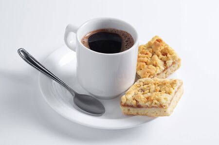 Cup of coffee and pastries with jam on white background