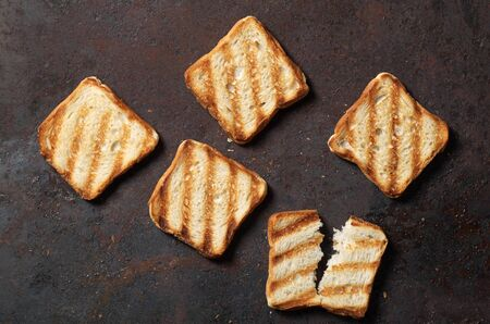 Grilled toasted bread on a metal grunge background, top view