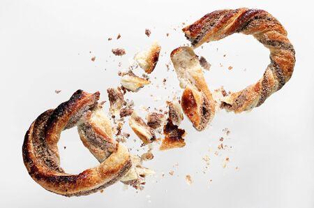 Sweet pretzel broken. White background, top view. Conceptual photo
