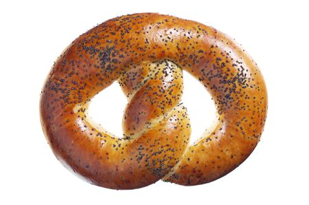 Soft pretzel with poppy seeds isolated on a white background close-up, top view Banco de Imagens