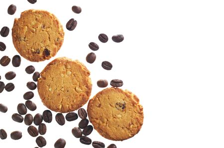Cookies with nuts and coffee beans isolated on a white background, top view. Copy space
