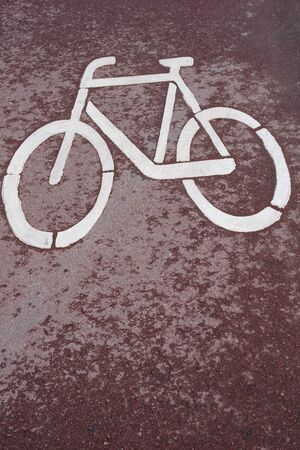 Close-up of a bike path with a sign