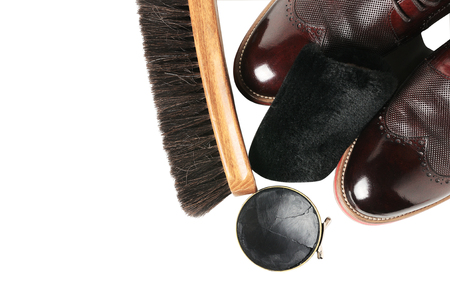 gripper: Isolated leather shoes on table with polishing equipment. Fashion shoes handmade. Wax. Wooden background