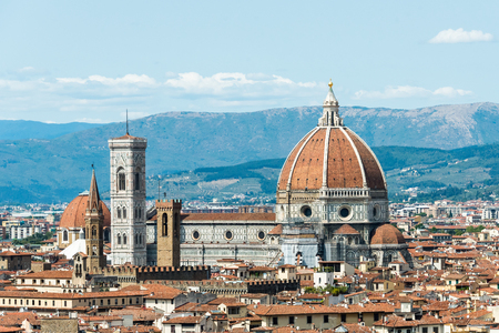 Cathedral of Santa Maria del Fiore on a background of mountains