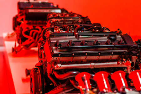 Sport engines with legendary power on red background and good perspective