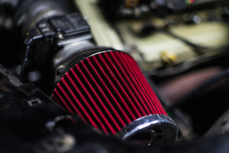 High performance red air filter of sport car with engine on back 免版税图像