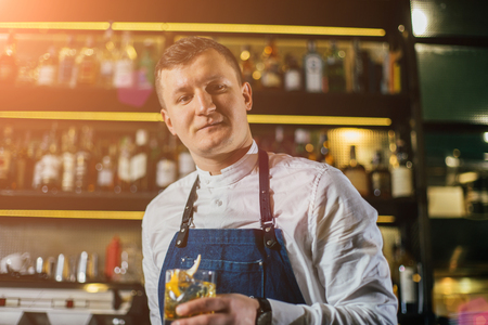 Bartender professionally working with om making drinks and cocktails Reklamní fotografie