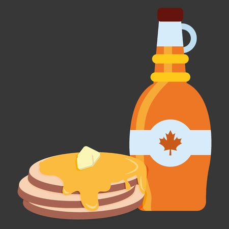 Bottle of maple syrup with pancakes