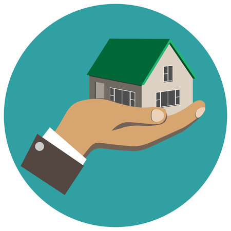 Businessman holding in hand a house