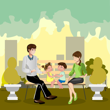 Famiglia seduta in un parco