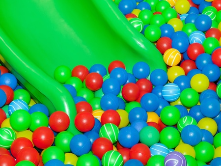 colored play: Playground slide and plastic balls