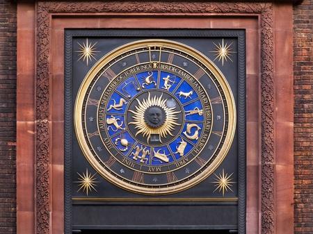 sun dial: Zodiac clock on a building in city of London