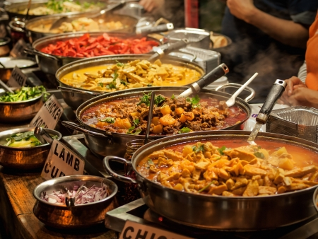 indian meal: Oriental food - Indian takeaway at a London s market  Stock Photo