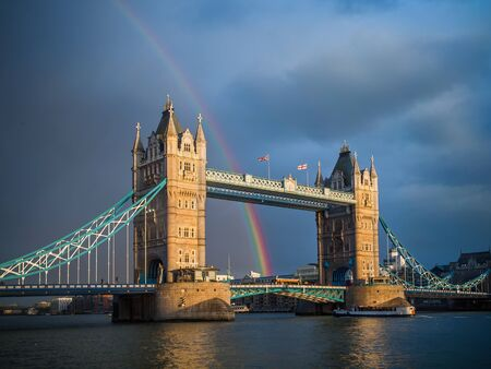 Tower Bridge at sunset with rainbow after storm