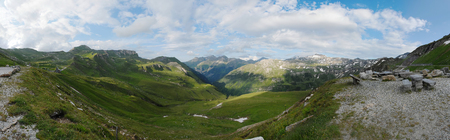 A great panorama or panoramic view of mountains from the highest surfaced mountain road in Austria - Grossglockner High Alpine Road. This panorama is good for a banner or a background. Stock Photo