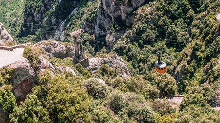 Beautiful view of the Aerial Cable Car at Montserrat, multi-peaked mountain range near Barcelona, Spain.