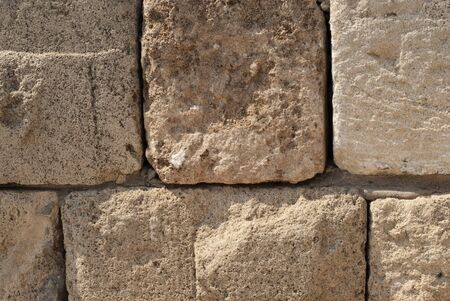 Fragment of old stone wall in one of streets of ancient Jaffa Port, Israel. Standard-Bild