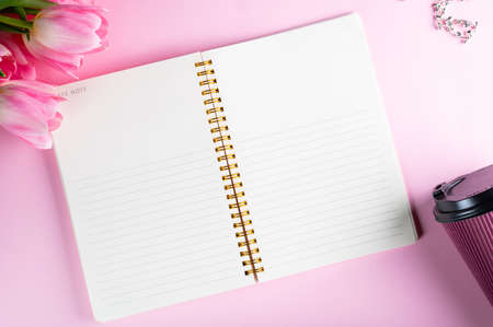 Top view flat lay empty note book with flowers. mockup. Text space. women flatly. Womens day flatlay. businesswoman flatlay. Empty notepad