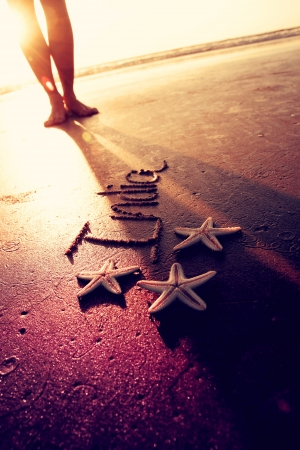Three starfishes and word  photo