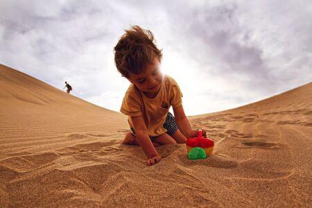 babyboy: Babyboy playing in a desert