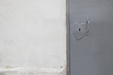 door knob: Door lock in the shape of a heart. Metal door. Wall. Background . Stock Photo
