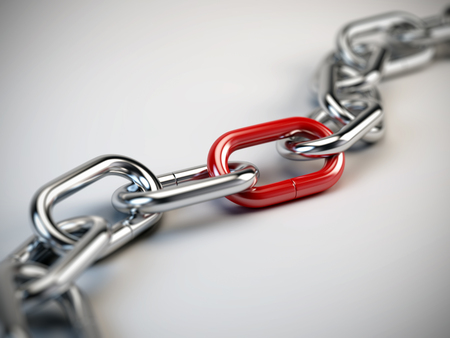 steel chain: Chrome chain with a red link Stock Photo