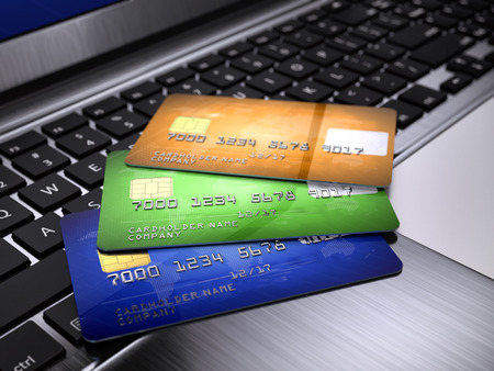 credit cards: Credit Cards on laptop keyboard