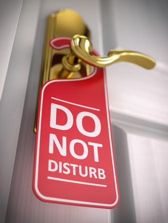 Do not disturb sign on hotel door handle