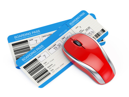airline: Airline tickets and computer mouse Stock Photo