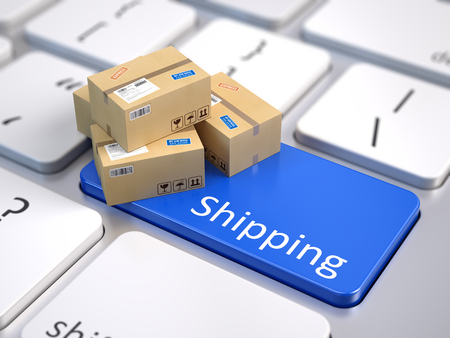 Cardboard boxes on computer keyboard - Shipping concept