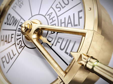 Full Ahead concept - Vintage ships engine room telegraph on full speed ahead