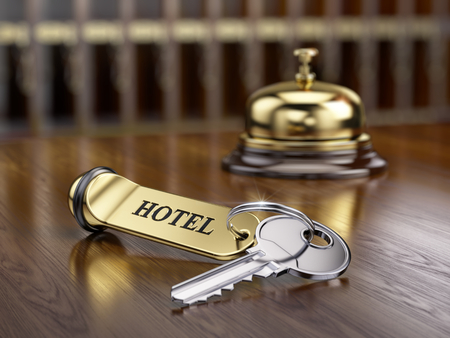 cardkey: Hotel key and reception bell on reception desk