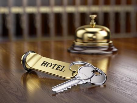cardkey: Hotel key and reception bell on reception desk