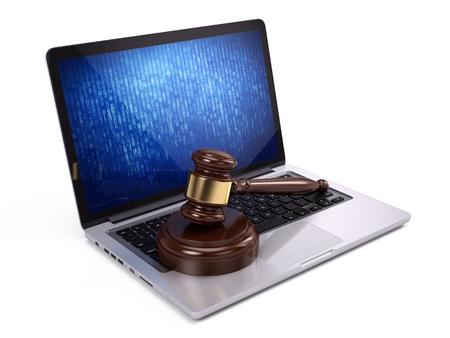 Law concept - Golden judge gavel on laptop
