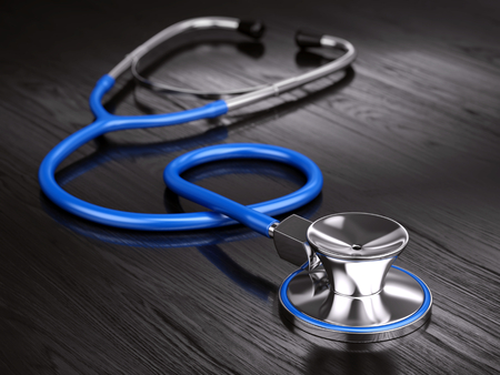 Stethoscope on wooden background