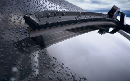 Car windshield with rain drops and frameless wiper blade closeup. 3d render Foto de archivo