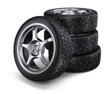 winter tires: Winter snow tyres with metal spikes isolated on white background. 3d render Stock Photo