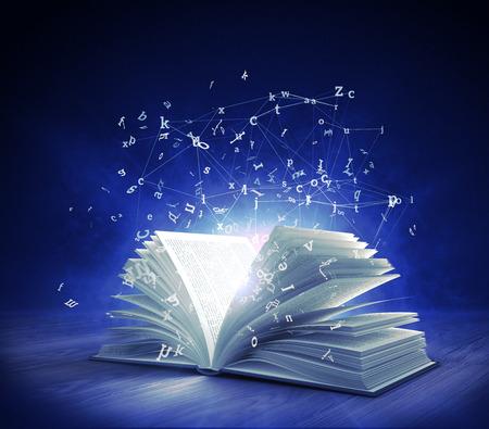 Libro mágico abierto con luz mágica y letras voladoras Representación 3d