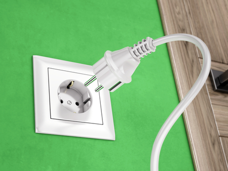 green power: Wall socket on green wall and power plug - 3d rendering Stock Photo
