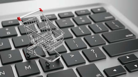 Online shopping concept - shopping cart on computer keyboard. 3d rendering
