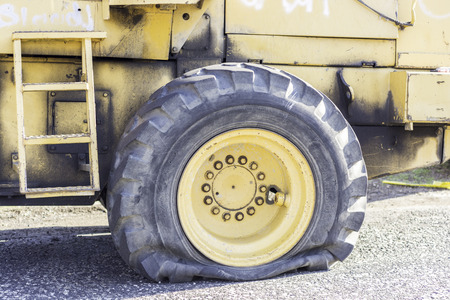 needed: Flat huge tire lots of work needed