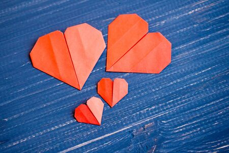 Family prepared for Valentines Day. Origami of heart. Concept of family. Point of view shot.